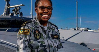 Able Seaman Michaelyn Waia on the forecastle of HMAS Launceston alongside HMAS Coonawarra, Darwin. Story by Sub-Lieutenant Nancy Cotton. Photo by Leading Seaman Shane Cameron.