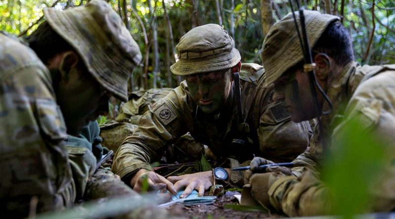Lieutenant David Adams, centre, from the 6th Battalion, Royal Australian Regiment, briefs Major David Hodge, left, at the Combat Training Centre - Jungle Training Wing, Tully, Queensland. Story by Captain Taylor Lynch. Photo by Corporal Brodie Cross.