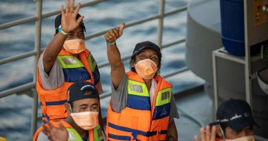 Rescued Indonesian fishermen wave goodbye to the crew of HMAS Anzac from the Indonesian Navy patrol vessel KRI Escolar following their return to Bali. Story by Lieutenant Geoff Long. Photo by Leading Seaman Thomas Sawtell.