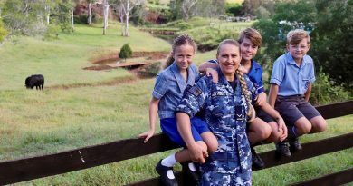 Leading Aircraftwoman Svitlana Pogrebnyak with her three children Christopher, centre, and twins Sophie and Matthew on their family property near RAAF Base Amberley in Queensland. Story by Flight Lieutenant Clarice Hurren.
