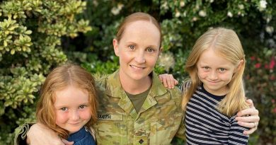 Captain Leigh Smith, a public affairs officer in the Army Reserve, with her daughters. Story by Venetia Reynolds.