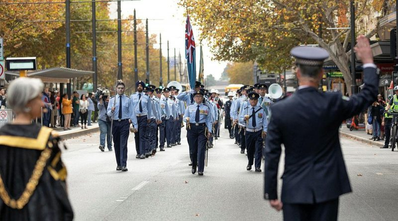 South Australian Police Chief Superintendant Stuart McLean challenges No. 24 (City of Adelaide) Squadron during a march along King William Street to Adelaide Town Hall. Story by Flying Officer Suellen Heath. Photo by Leading Aircraftman Sam Price.