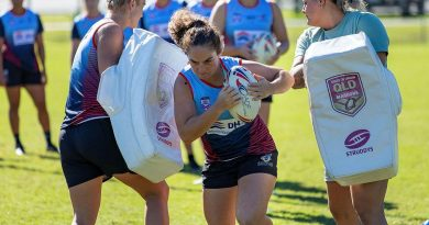 Private Kiara Hawkins from the Australian Defence Force Woman's Rugby League team charges the hit pads during a training session at Leslie Patrick Park in Arana Hills, Brisbane. Story by Private Jacob Joseph. Photo by Leading Seaman Steve Thomson.