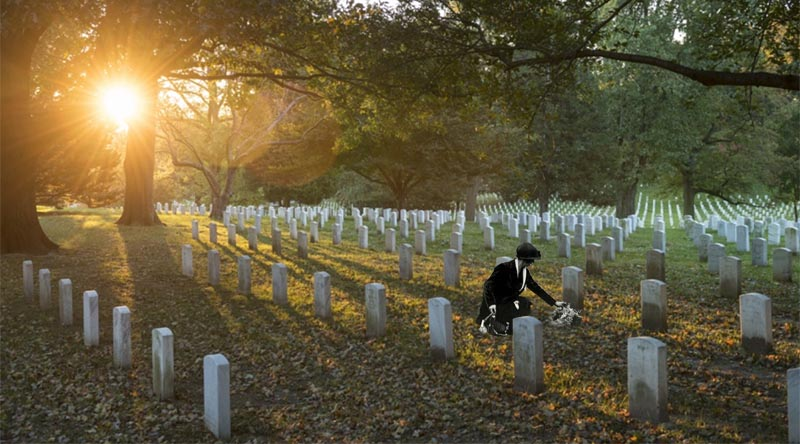 Original photo:Sunrise in Section 35 of Arlington National Cemetery, Arlington, Virginia. US Army photo by Elizabeth Fraser/Arlington National Cemetery. Grieving mother digitally inserted by CONTACT.