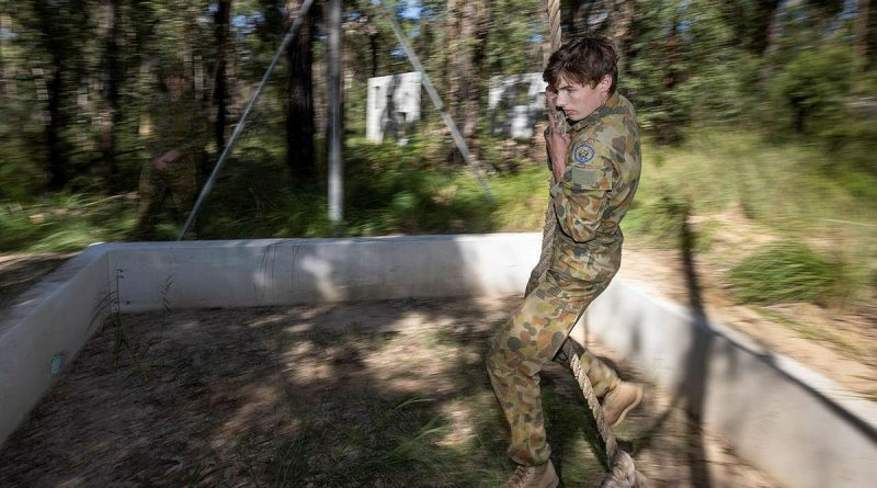 Cadet Warrant Officer Class 2 Hunter Folkes, of Sydney Grammar Army Cadet Unit, swings over the rope pit during the Adventure Training Award at Holsworthy Barracks. Photo by Trooper Jarrod McAneney.