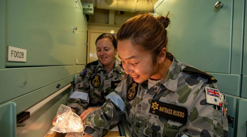 Leading Seaman Tayler Hawkins, left, and Able Seaman Katie Nattrass Russo conduct a stores muster on board HMAS Ballarat during the ship's current regional presence deployment. Story by Lieutenant Gary McHugh. Photo by Leading Seaman Ernesto Sanchez.