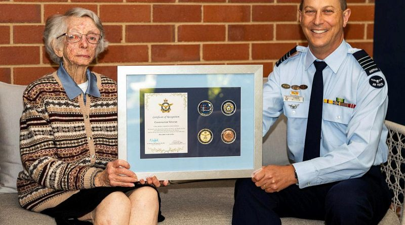 Women's Auxiliary Australian Air Force veteran Beryl Barton is presented an Air Force 2021 commemorative memento by Senior Australian Defence Force Officer RAAF Base Wagga Group Captain Chris Ellison. Story by Flight Lieutenant Lana Woodhouse. Photo by Sergeant John Marshall.