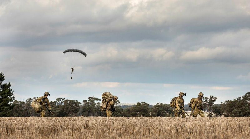 Soldiers from 2 Commando Regiment depart the drop zone after parachuting into crop fields in Temora, NSW. Story by Sergeant Janine Fabre. Photo by Sergeant Janine Fabre.