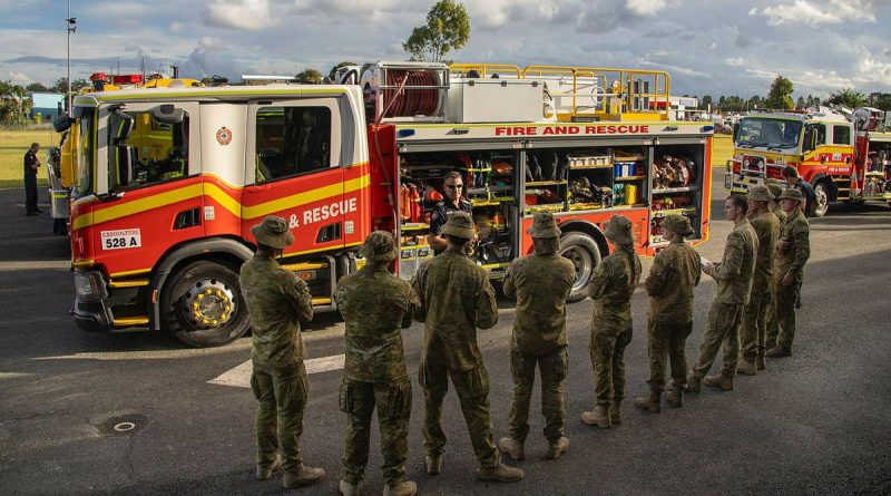 Members of 2/14 Light Horse Regiment (Queensland Mounted Infantry) receive a briefing from the Queensland Fire and Emergency Services during Exercise Incendium on the Sunshine Coast. Story by Captain Jesse Robilliard. Photo by Sergeant Brendan Davis.