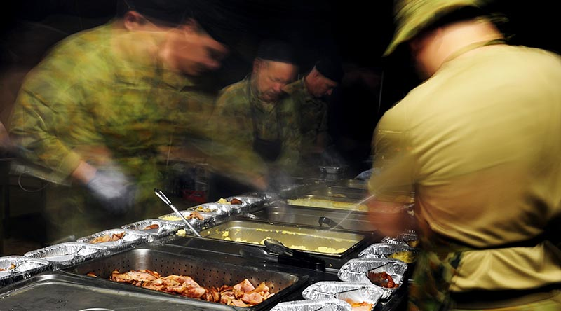 Australian Army chefs and stewards prepare 'hot-box' meals in a field kitchen at Shoalwater Bay, Queensland, during Exercise Talisman Saber 2013. Photo by Corporal Jake Sims.