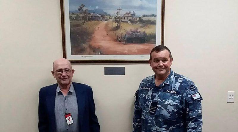Frank Winnell and Commanding Officer No. 31 Squadron Wing Commander Nick Pausina with the gifted Darcy Doyle print at RAAF Base Wagga. Story by Wing Commander Nick Pausina.