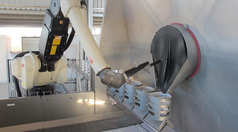 The robotic arm of the Semi-automated Explosive Ordnance Inerting Capability and the filtered catch-buckets that collect the extracted material.