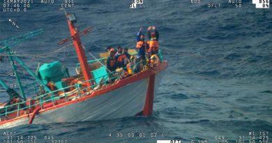 Indonesian fishermen wave to a RAAF P8-A Poseidon from their sinking fishing trawler 670 nautical miles off Perth, WA.