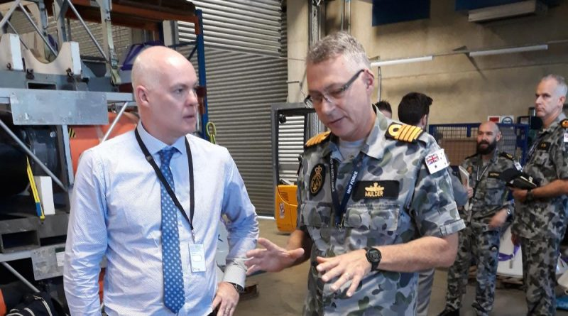 Director of Mission Systems PTY David Battle discusses with Captain Etienne Mulder from the Mine Warfare and Clearance Diving Group about the use of a generator used to jam mine firing systems. Story by Lieutenant Commander Alan Parton.