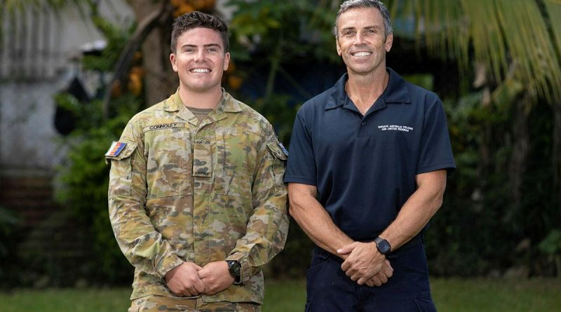 Signaller Jack Connoley with his father, Australian Federal Police Federal Agent John Connoley, at the Vanuatu Police Training College in Port Vila. Story by Corporal Olivia Cameron. Photo by Corporal Olivia Cameron.