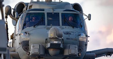 Royal Australian Navy pilots Lieutenant Benjamin Flood and Lieutenant Commander Matthew Schroder at the controls of an 816SQN MH-60R helicopter on HMAS Ballarat. Photo by Leading Seaman Shane Cameron.