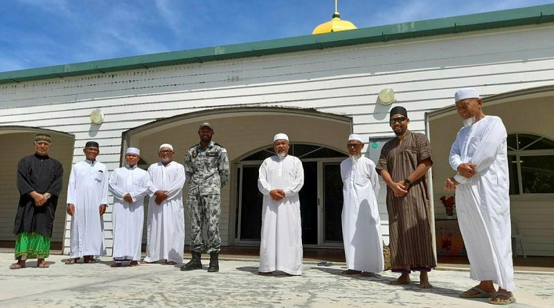 Able Seaman Ebrahim Dollie with members of the Cocos Keeling Islands mosque. Story by Lieutenant Gordon Carr-Gregg. Photo by Lance Corporal Casey Flanagan.