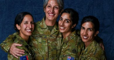 Private Shamila Muthia Azami, second from left, with her daughters Private Seema Muthia, left, Private Uma Muthia, and Private Anissa Muthia at Oakleigh Barracks, Melbourne. Story by Captain Kristen Cleland. Photo by Private Michael Currie.