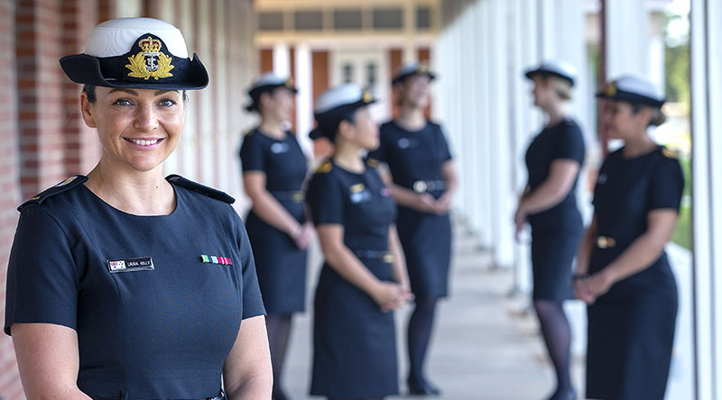 Midshipman Laura Kelly and classmates from the inaugural Maritime Human Recourse Officers Course showcase the Royal Australian Navy's new winter black dress at HMAS Cerberus in Victoria. Photo by Petty Officer James Whittle.