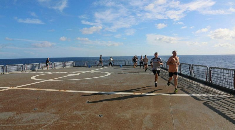 Participants in the HMAS Sirius parkrun event run laps on the ship's flight deck. Story by Lieutenant Geoff Long. Photo by Lieutenant Sarah Lucinsky.