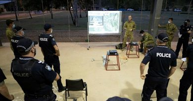 Corporal Ryan Waterham, from the 3rd Battalion, Royal Australian Regiment, demonstrates the unit's unmanned aerial system to Queensland Police officers at Lavarack Barracks. Story by Captain Lily Charles. Photo by Corporal Brandon Grey.