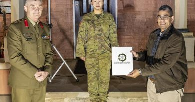 Reservist Private Izzy Kim, centre, with her civilian employer, manager Digital Analytics and Business Enablement at HCF Australia Hari Somayajula receiving a certificate of appreciation from Brigadier Mick Garraway. Story by Alex DeValentin. Photo by Corporal Dan Pinhorn.