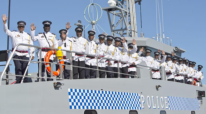 Ship's company of Royal Solomon Islands Patrol Vessel Taro line the upper deck after boarding their vessel for the first time following a formal handover ceremony at Henderson, WA. Photo by Able Seaman Annabelle Reidy.