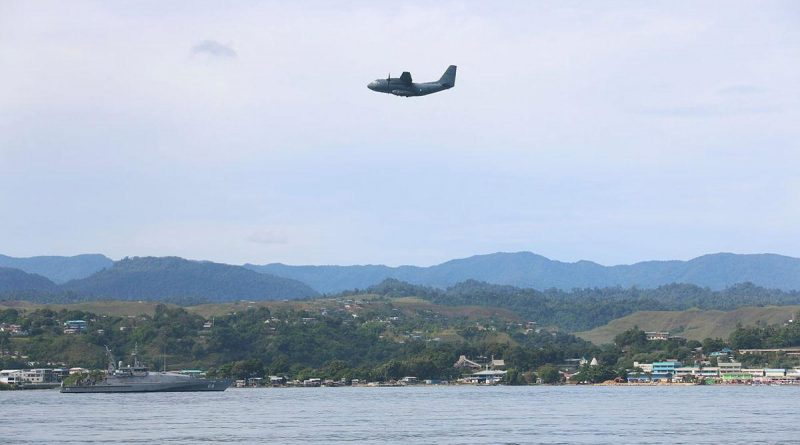 An Air Force C-27J Spartan flies over HMAS Maitland off the coast of Honiara, Solomon Islands, during Operation Solania. Story by Major Anna-Lise Brink. Photo by Seaman Isaiah Appleton.