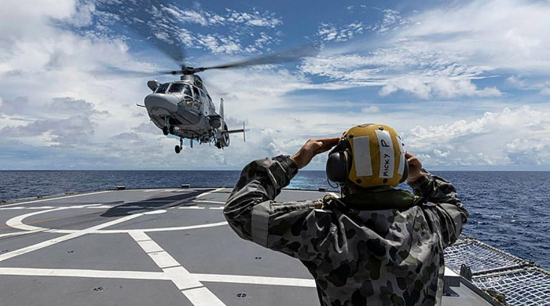 A French Navy helicopter from FS Tonnerre approaches HMAS Parramatta as the two ships sail together in the South China Sea. Story and photo by Leading Seaman Jarrod Mulvihill.