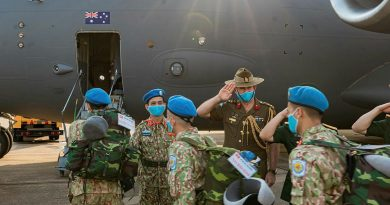 Australian Defence Attache to Vietnam Colonel Paul Foura and senior Vietnamese officers farewell Vietnamese Level Two Field Hospital personnel as they board an Air Force C-17A Globemaster III in Ho Chi Minh City. Photo by Cần Thơ Kỷ Yếu
