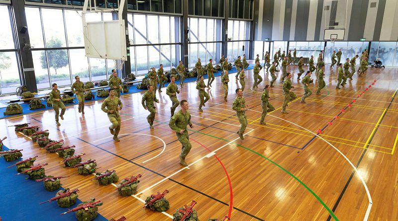 An Australian Army physical training instructor takes candidates through a warm-up before starting the Special Forces Entry Test at Holsworthy Barracks, Sydney, on Monday, 01 March 2021. Story by Lieutenant Anthony Martin. Photo by Leading Aircraftwomwan Jacquelline Forrester.