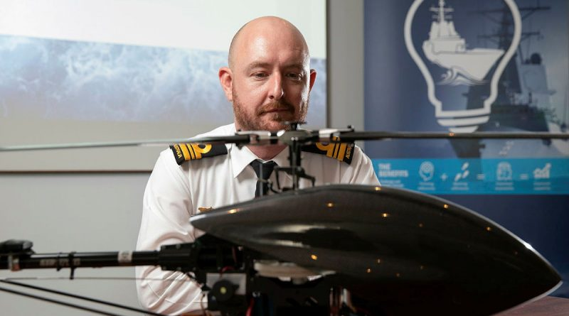 Lieutenant Commander Bryan Cromie from the Robotic Autonomous Systems and Artificial Intelligence Team, Warfare Innovation Navy Branch, with a remotely piloted aircraft at the virtual Autonomous Warrior event in Canberra, ACT. Photo by Petty Officer Bradley Darvill.