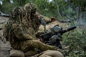 CAPTION: Soldiers from the 6th Battalion, Royal Australian Regiment fire an Automatic Grenade Launcher during a live-fire defence serial held for Exercise Diamond Walk at Shoalwater Bay, Queensland. Photo by Private Jacob Hilton.