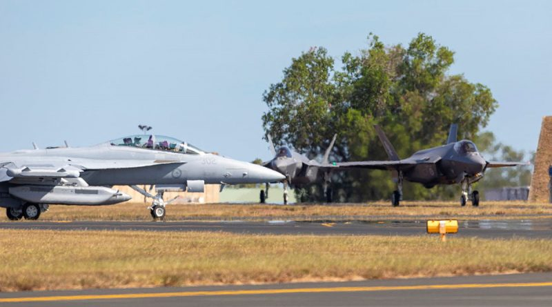 An Air Force EA-18G Growler, aircraft taxis past two F-35A Lightning II aircraft on its way to the runway, during exercise Arnhem Thunder held at RAAF Base Darwin, Northern Territory. Photo by Leading Aircraftman Stewart Gould.