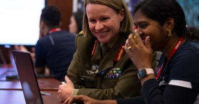 """Head Information Warfare Major General Susan Coyle, CSC, DSM (left) meets with Australian Defence Force Cyber Gap Program participant Shobita during a """"capture the flag"""" cyber skills challenge. Story by Corporal Julia Whitwell."""
