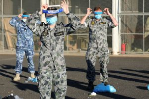 Seaman Haley Coleman and other Australian Defence Force members practice correct application of Personal Protective Equipment (PPE). Captain Kristen Daisy Cleland.