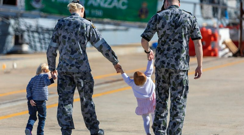 (L-R) Lieutenant Brittany Craig and HMAS Anzac Flight Commander, Lieutenant Commander Timothy Craig with their children (from left) Hunter and Harper at Oxley Wharf at Fleet Base West, Western Australia. Story by Harriet Pointon Mather. Photo by Leading Seaman Ronnie Baltoft.