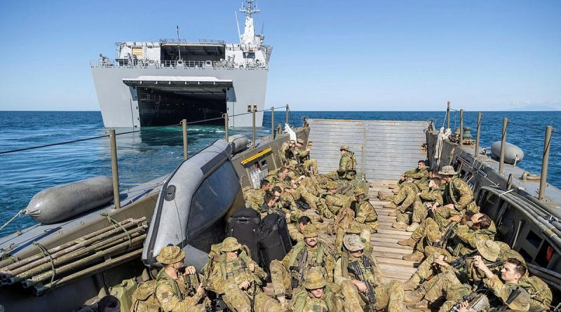 Soldiers from the 2nd Battalion, Royal Australian Regiment, on board an Australian Army LCM-8 landing craft depart HMAS Canberra for beach landing serials during Exercise Sea Explorer. Story by Captain Dan Mazurek. Photo by Leading Aircraftwoman Jacqueline Forrester.