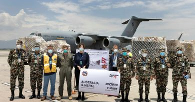 Australian Ambassador to Nepal, Her Excellency Felicity Volk and Lieutenant General Prabhu Ram Sharma Chief of General Staff stand with guests during Australia's handover of humanitarian aid stores to the Nepali Army at Tribhuvan International Airport in Nepal. Story by Leading Seaman Craig Walton. Photo by Corporal Robert Whitmore.