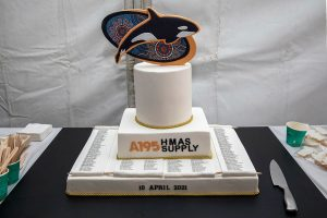 HMAS Supply's commissioning cake with killer whale and indigenous art background at Fleet Base East in Sydney, New South Wales. Photo by Petty Officer Justin Brown.