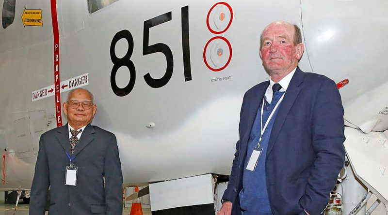Skipper of refugee boat Nghia Hung, Tam Van Nguyen, with Royal Australian Navy Reserve Captain Chris Frost in front of Grumman Tracker 851 at the HARS Aviation Museum, Albion Park, NSW. Story and photo by Sergeant Dave Morley.
