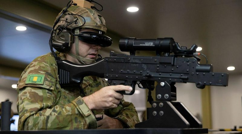 Private Shaun Causer, of the 5th Battalion, Royal Australian Regiment, operates a simulated MAG 58 machine gun as part of convoy simulation training with the Protected Mobility Tactical Trainer at Robertson Barracks. Story by Captain Peter March. Photo by Corporal Rodrigo Villablanca.