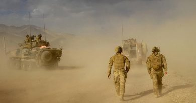 Soldiers from Mentoring Task Force – Three (MTF-3) move away from a helicopter landing zone, after loading Australian casualties wounded by an improvised explosive device on a Bushmaster, in the Chora Valley, southern Afghanistan. Photo by Able Seaman Jo Dilorenzo.