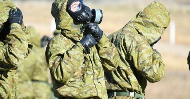 An Army recruit fits his chemical, biological, radiological and nuclear defence (CBRND) suit during Army's first CBRND basic course using the latest versions of the equipment.