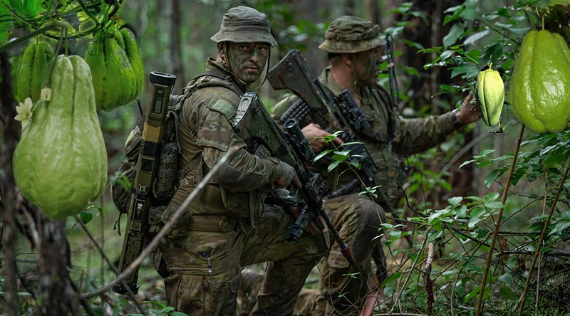 Australian Army Private Sam Randall and Corporal James Milne from the 8th/9th Battalion, Royal Australian Regiment on Exercise Wolf Crawl, at the Canungra Field Training Area, Queensland. Base photo by Private Jacob Hilton. Digitally added to by CONTACT.