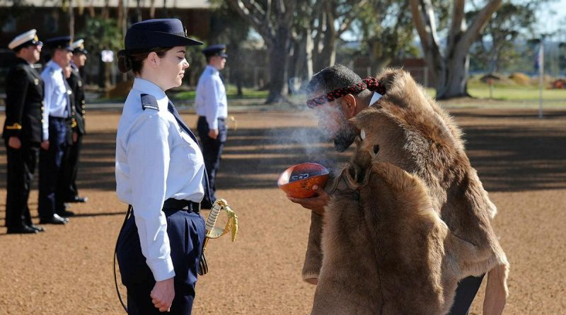 Pilot Officer Christina Way participates in a traditional smoking ceremony conducted by Whadjuk Elder Barry Winmar during the No. 261 Advanced Pilot Course Graduation at RAAF Base Pearce, WA. Story by Flight Lieutenant Julia Ravell. Photo by Chris Kershaw.