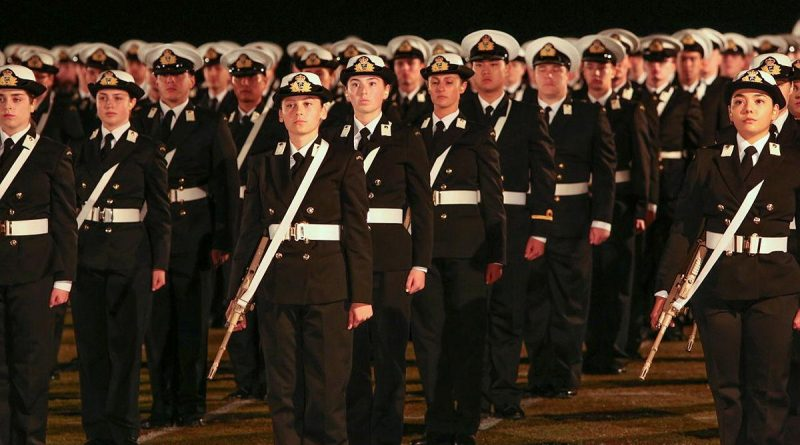Graduates of the New Entry Officers Course 64 parade stand at attention during a ceremonial sunset on the evening before their graduation at HMAS Creswell, Jervis Bay. Story by Lieutenant Sarah Rohweder. Photo by Able Seaman Leon Dafonte Fernandez.