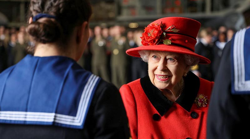 Queen Elizabeth talks with members of the ships company of the Royal Navy aircraft carrier HMS Queen Elizabeth in Portsmouth on 22 May 2021, just hours before the UK Carrier Strike Group sailed for its first operational deployment. UK MoD Crown copyright. Photo by Petty Officer Jay Allen.