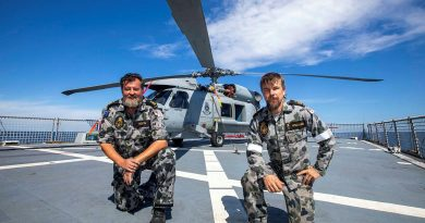 Petty Officers Andrew Booth, left, and Patrick Williams, from 816 Squadron's Flight 3 crew, with HMAS Ballarat's embarked MH-60R. Story by Lieutenant Gary McHugh. Photo by Leading Seaman Ernesto Sanchez.