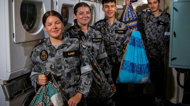 Able Seamen Cerys Zurek and Abbi Greenaway, Seaman Tiago Torres and Able Seaman Richard New display their personalised dhoby bags in the laundry of HMAS Ballarat. Story by Lieutenant Gary McHugh. Photo by Leading Seaman Ernesto Sanchez.